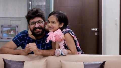 Indian dad and little girl playing in their living room - happy family