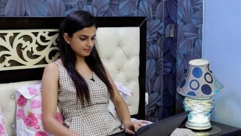 Young woman doing work from home due to the outbreak of coronavirus in India