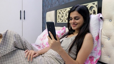 Indian girl having a video call via smartphone - distance communication concept