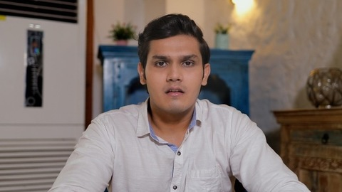 Point of view shot of a handsome Indian man busy over an online job interview