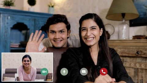 Screen view of young college friends happily talking over a virtual video chat