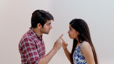 Young Indian couple fighting and shouting at each other during a heated argument