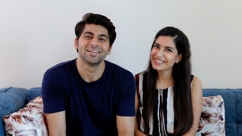 Attractive Indian couple happily talking to their friends over a video call/chat