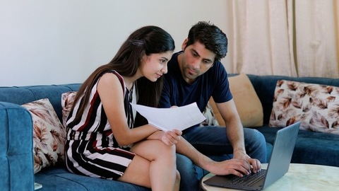 Young Indian couple working together and discussing their project plan