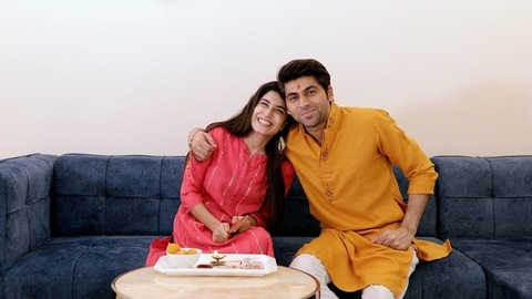 Indian brother and sister in traditional wear celebrating Raksha Bandhan festival