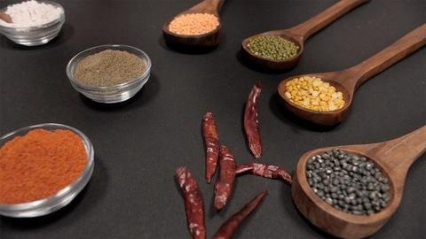 Sabut Urad(black), Chana(yellow), Moong(green), Masoor(red) pulses kept with spices
