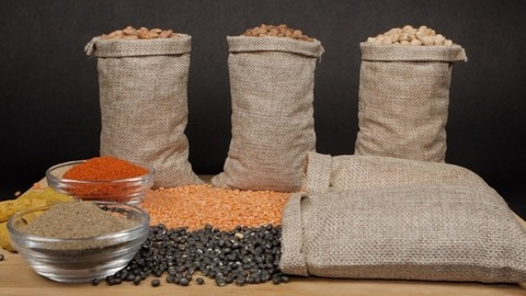 Rich protein source - Collection of lentils/dals/pulses in jute bags kept with powdered spices