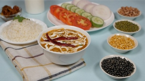 Pan shot of table set with a popular Indian meal Dal Makhani served with plain rice