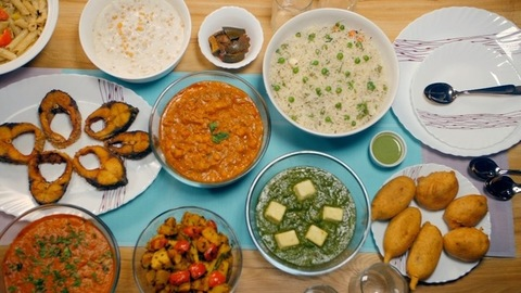 Variety of vegetarian and non-vegetarian food served on the dining table