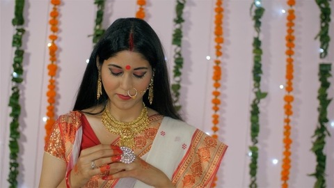 Beautiful Bengali woman happily getting ready for the Durga Puja celebrations