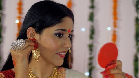 Attractive Indian female getting ready for the Durga Puja festival or celebration