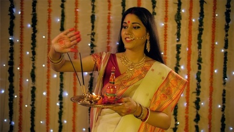 Beautiful Indian female spreading sacred smoke to cleanse and purify her home