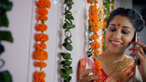 Pretty Bengali woman talking on a phone during the Durga Puja celebrations
