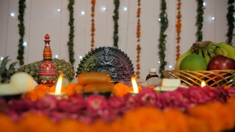 Pan shot of a beautifully decorated platform with Hindu idol Goddess Durga