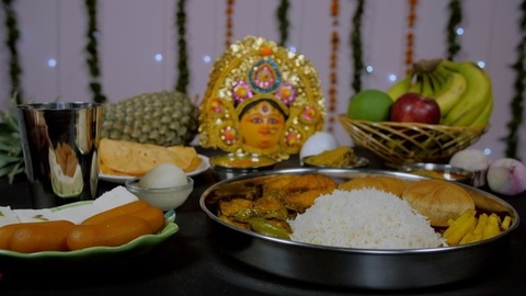Decorated Puja room during Durga Puja festival with Bhog/Prasad items
