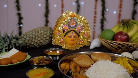 Traditional Bengali Thali/platter as offerings for Ma Durga rotating on a turntable