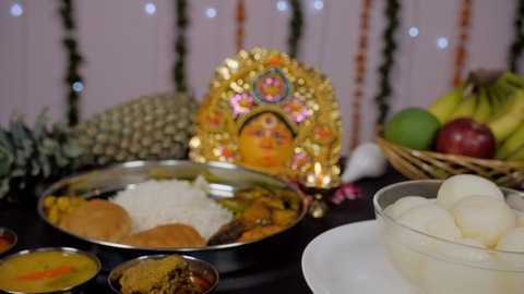 Traditional Bengali thali with a bowl of Rosogolla during Durga puja celebration
