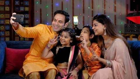 Small Indian family - Celebrating Diwali together, Clicking a selfie during Diwali