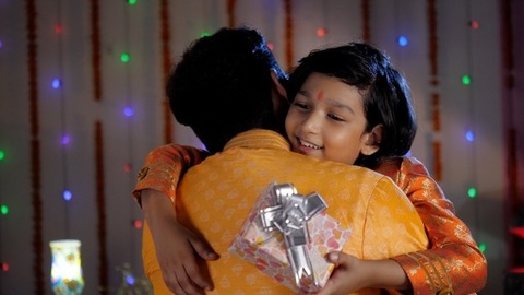 Father and son bonding during Diwali celebration - Son hugging father
