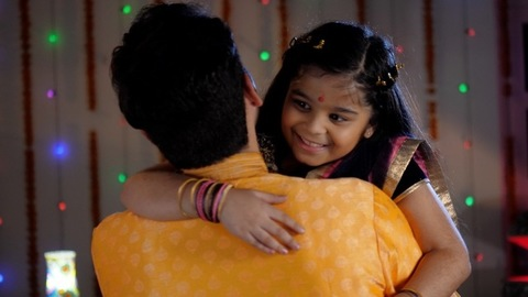 A cute adorable girl hugging her father - Love and Bonding with parents