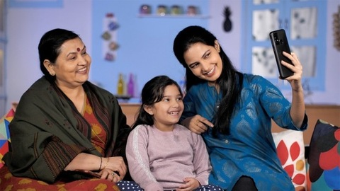 A family of three women making a video call - relationship and bonding