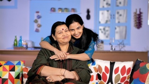 An adult daughter hugging her mother to make her happy - happy family