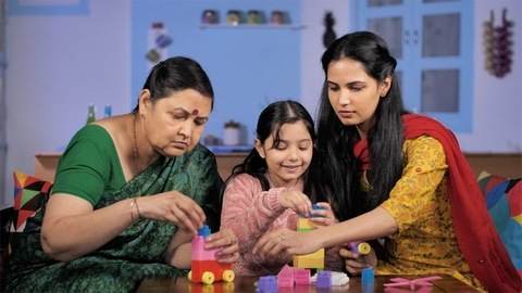 Pretty Indian girl playing indoor games with her mother and grandmother - Quarantine life