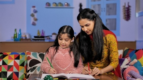 Young Indian mother teaching her school-going daughter - togetherness and bonding
