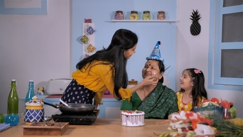 An old lady tasting the delicious cake made by her daughter - home cooking