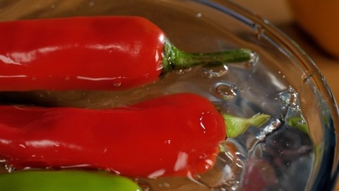 Rajasthani plump big red and green chilies in a bowl of water - spicy food