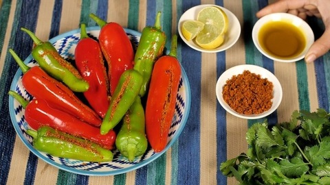 Rajasthani Mirchi Ka Achaar / stuffed chili pickle placed on a colorful background