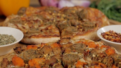Zoom in shot of two non-vegetarian pizza loaded with big chunks of chicken