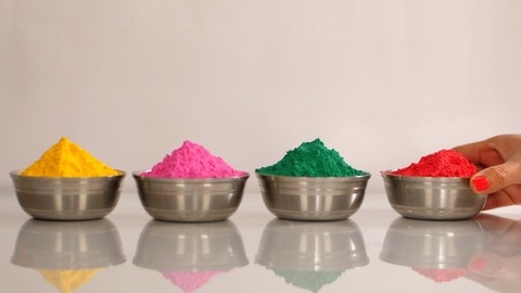 Multicolor Gulal (Holi colors) in metallic bowls to celebrate the Holi festival