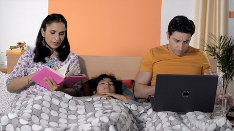 Busy parents working at night - Hectic lifestyle in modern days