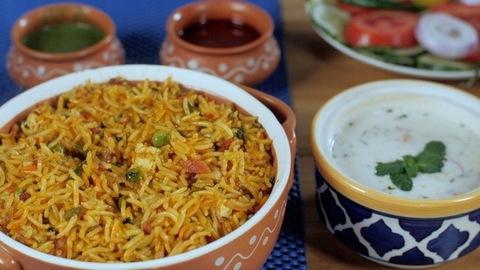 Homemade vegetarian Biryani served with Raita, Chutneys, and fresh salad
