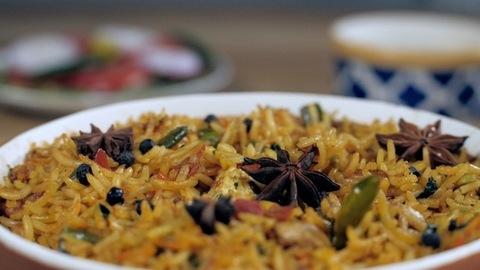 Rotating bowl full of spicy Indian vegetarian Biryani - delicious famous food