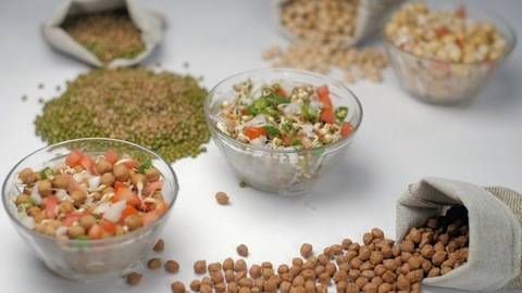 Sprouted chickpeas salad mixed with chopped onions, tomatoes, and chilies