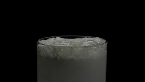 Fizzy beverage / soda drink mixed with water in a transparent glass