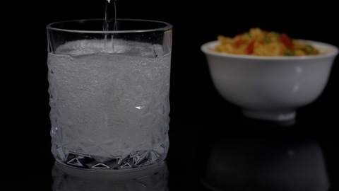 Refreshing fizzy drink / juice poured in transparent glass - a cool beverage