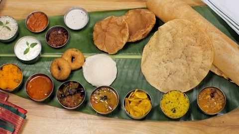 Assorted South Indian cuisine served on a traditional banana leaf - tasty food