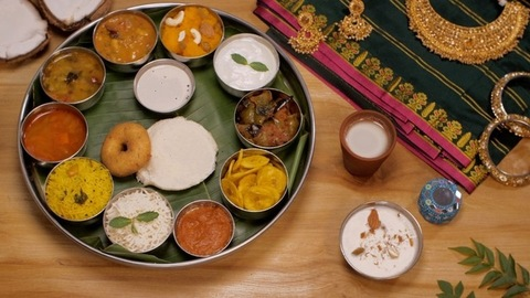 South Indian vegetarian Thali, wedding jewelry, silk Saree, and coconut halves