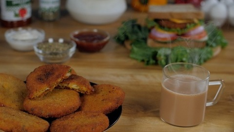 Smoke coming out of hot tea / coffee served with crispy vegetarian patties for breakfast