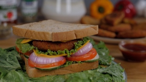 A delicious healthy vegetarian sandwich kept on a plate rotating on a turntable