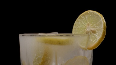 Refreshing soft drink with yellow citrus lemon and soda - summer beverage