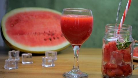 Water / soda tonic pouring into a glass jar with sliced watermelon and mint leaves - Summer fruit India