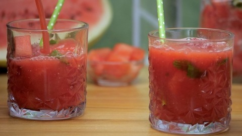 Fresh watermelon juice with mint leaves and ice cubes pouring in a glass -  Summer fruit India