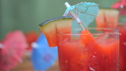 Small pieces of watermelon dropping inside a glass of juice - summer drink India