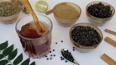 Flavored herbal tea with bubbles poured in transparent glass in the morning - Blacktea
