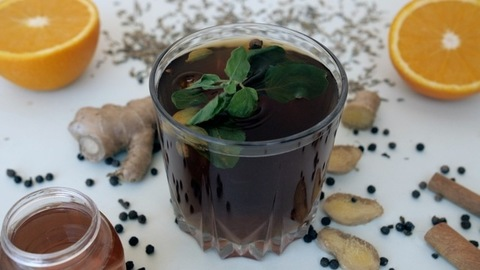 A healthy beverage herbal tea decorated with Tulsi leaves served for breakfast