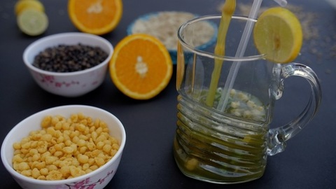 Indian summer drink Jaljeera with a straw decorated with a lemon slice in a glass